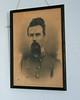 Confederate officer portrait hanging in sheriff's quarters bedroom