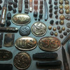 <b>Visitor Center</b> - A collection of battlefield 'souvenirs' including belt buckles, buttons, knives, and bullets...
