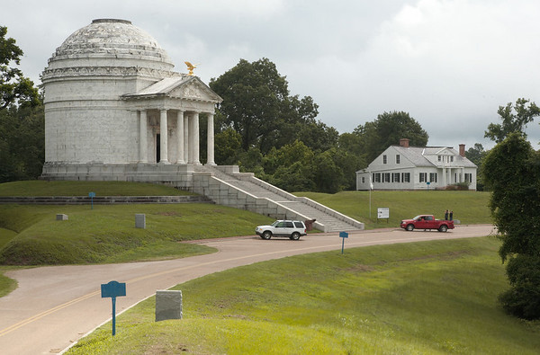 The Illinois Memorial with the Shirley House, an original Civil War structure in the background, at Vicksburg National Military Park.