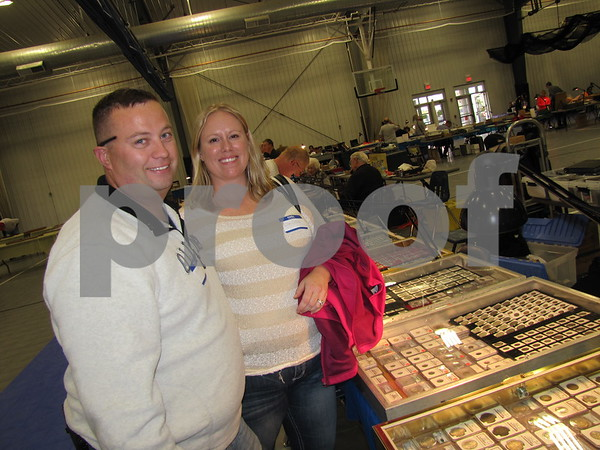 Jeff and Lisa Collins enjoyed looking over the collections of coins.