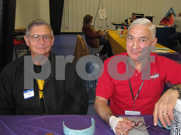 John Porter and Pete Fritz of the Fort Dodge Coin Club welcomed visitors to the Iowa Numismatic Association's 74th Annual Coin Show held at the Career Education Building on the ICCC campus.