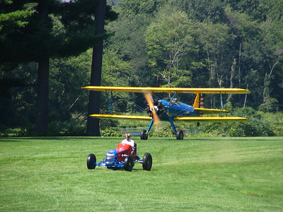 Race 5 - 1942 PT-17 Stearman Bi-plane vs. 1937 Offy Sprint Racer (draw)
