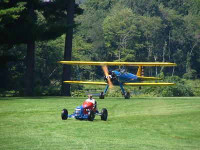 Race 5 - 1942 PT-17 Stearman Bi-plane vs. 1937 Offy Sprint Racer (draw)