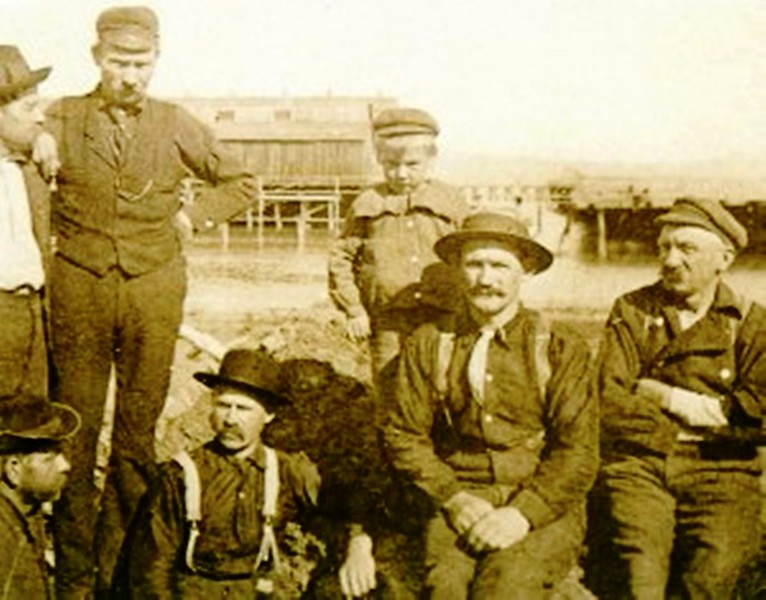 Alderbrook Station  August  Moberg Standing Second From Left  his son James Dalgity Moberg standing his  Left next to him at Scandivavian Cannery Astoria Oregon Columbia River