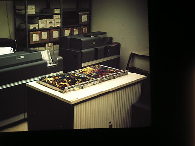 1940 IBM 402 Computer Programming  Board, Left IBM 407 Accounting Machine. Background right IBM 519 Summary card punch machine.