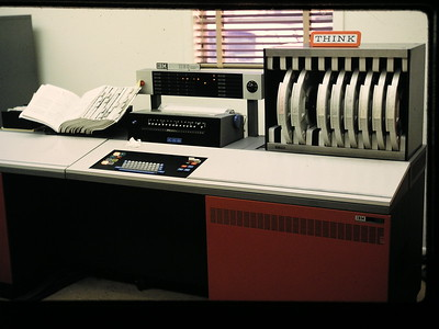 IBM 1130 computer console, red panel opens to insert 1 removal disk. http://en.wikipedia.org/wiki/IBM_1130
