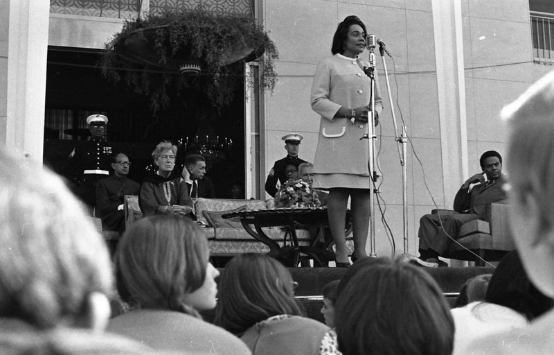 Coretta Scott King speaking to students from the American International School in New Delhi, India, January 1969. Civil Rights leader Andrew Young is seated at far right.