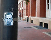 This sticker is on a lamp post next to the old school book depository building.