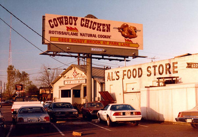 COWBOY CHICKEN And here we have the billboard for Cowboy Chicken that the previous photo was used for. The store at Shady Brook and Park Lane was the first one (est. 1981) in what has become a very popular franchise in Dallas. I think the store is just to my right. I can't remember now.