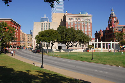 View from the grassy knoll.  Near the lower right of the pic you can see the X in the road that marks where the fatal shot hit JFK.