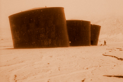 Old oil tanks in a gentle blizzard.