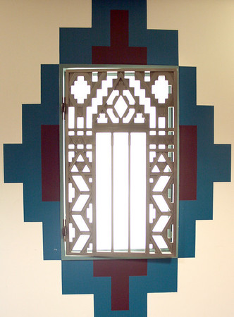 Record-Eagle/Loraine Anderson<br /> One of three surviving teller windows that survived World War II metal collections is part of a wall design in the basement of the Guardian Building.