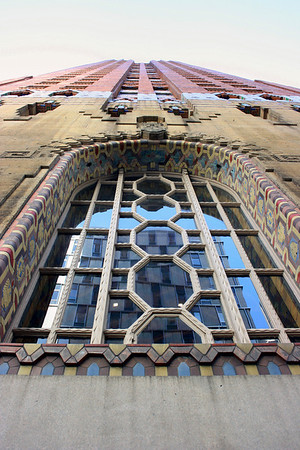 Record-Eagle/Loraine Anderson<br /> Pewabic mosaic around the massive arched window on exterior wall along Congress Street wall includes medallions symbolizing finance, thrify and industry - symbols for finance, thrift and industry. The 40-story building stands 486 feet tall.
