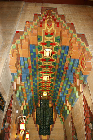 Record-Eagle/Loraine Anderson<br /> The notched arch is a repeated theme throughout the Guardian Buidling.  Here it appears in the ceiling in one of the two elevator lobbies and also above the elevator doors on the right and left.
