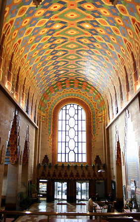 "The Rookwood Pottery mosaic in the vaulted ceiling of the Guardian Building's main lobby depicts a colorful streaming Indian headdress that starts at the monumental arched window and extends back toward the banking hall. The Guardian Building is often called the ""Cathedral of Finance"" because its <br /> a vaulted ceilings, naves and apses give a cathedral feel to the lobbies."