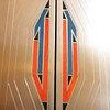 Record-Eagle/Loraine Anderson<br /> An interlocking U and T, the monogram of the Union Trust Ban, is inset in each of the Montel metal elevator doors in the lobby.  The letters are made of orange and blue Favrile glass tile.