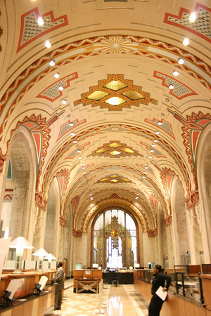 Record-Eagle/Loraine Anderson<br /> Eighty teller cages once lined both sides of the upper banking all.  This view is taken at the south wall near the Michigan mural looking south to the metal gate to the lower main lobby.  Geometric designs in the vaulted ceiling are repeated in the floor.