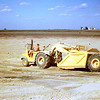 Steve on 5010 John Deere scraper out at clay pit  ~  1969