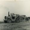 Steve operating John Deere JD 760-A scraper in clay pit  ~  1971