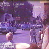 DOLTON, IL JULY 4th PARADE  <br /> Still from home movie.  Gas For Less had that drive through to the other side on Greenwood Road.  Dolton Department store is in the distance on 142nd.