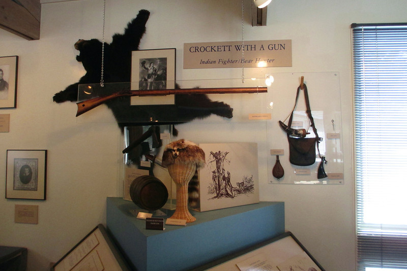 A series of displays traced the various stages in the life of Davy Crockett from frontiersman to Indian fighter to Congressman to Alamo martyr...