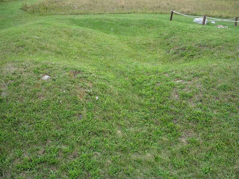 An unmarked mound next to the blacksmith shop...