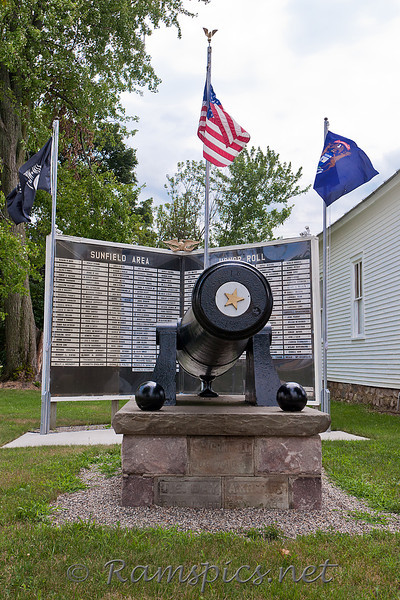 Historic canon and honor role sign in front of the G.A.R. hall and museum in Sunfield.