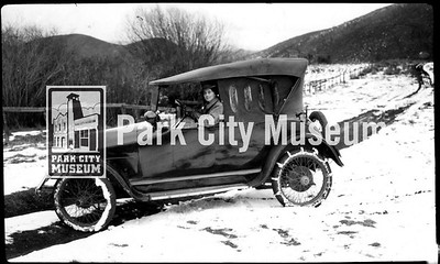 Carrie Vivian Hodgson driving on snowy road, ca.1920s (Image: 1999-4-270, Park City Mountain Resort Collection)
