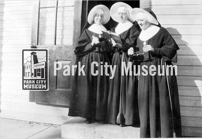 Three nuns looking at an open book together. circa 1920's (Image: 2003-23-24, PCHS Photograph Collection)