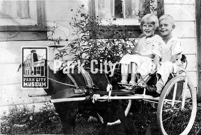 Park City cousins, Elda Yates and Bennie Bircumshaw, in a goat cart. Circa early 1930's. (Image: 2016-12-20, JoAnn Green Collection)