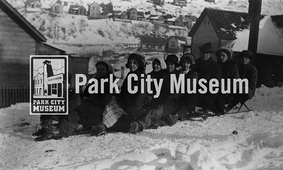 Sledding party above Main Street on west side of canyon. Rossi Hill homes in background. Circa 1900. (Image: 1986.3.8, Mel Fletcher Collection)