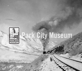 Salt Lake City side of Parley's Summit looking west.  Track opened in 1890 by Utah Central; Rio Grande took over in 1898.  Travel time to SLC cut from 4 hours to 2 hours. Circa 1930's. (Image: 1984.102.3, Nan McPolin Collection)
