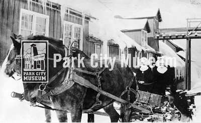 "Two nuns driving a horse-drawn wagon in the snow near a mine building. The caption reads ""Yes we have butter and eggs"" suggesting they were out in the winter selling these items. circa 1920's. (Image: 2003-23-2, PCHS Photograph Collection)"