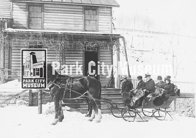 Ontario Silver Mining offices.  R.C. Chambers, superintendent, in front with driver. Passengers in back are Solon Spiro, president of Silver King Consolidated Mines, and his wife. circa 1900. (Image: 1984.52.8, United Park City Mines Collection)