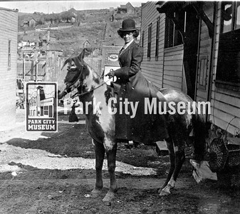 Mrs. Carrie Vivian Hodgson on her pinto horse on Fourth Street with Main Street and Rossie Hill in the background. (Image: 1998-6-352, PCHS Photograph Collection)
