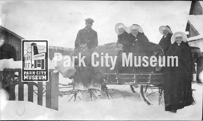 "Four nuns readying for a sleigh ride with their drivers. Caption reads, ""A Ten Mile Ride"". circa 1920's. (Image: 2003-23-3, PCHS Photograph Collection)"