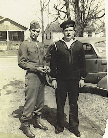 1. The processing date on this one was April 2, 1945, so I guess this shot of dad and his nephew, Garvin Pyron, was taken in Humboldt on that 4th furlough. It's in the driveway at Uncle Ovie's on Mitchell.