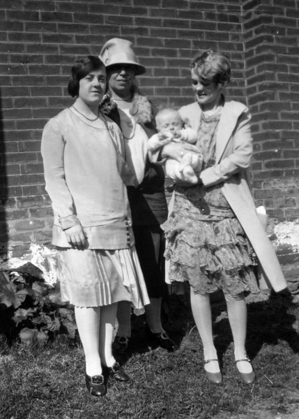 Dorothy Corson Russel, Adelaide Mary (Griffith) Barrett, Melville Laird Gordon and Jessie Barrett (Russel) Gordon. Melville Laird Gordon's Christening, 1928, Dixie, Peel, Ontario, Canada at the residence of Thomas Laird Kennedy.