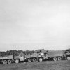 Photo courtesy of Fred Korb<br /> An American convoy transports German soldiers who have surrendered to processing areas.