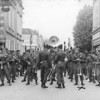 Photo courtesy of Fred Korb<br /> The trombone section and the crowd  before a victory parade in a French village.
