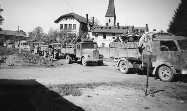 Photo courtesy of Fred Korb<br /> Convoy trucks of surrendering Germans arrive at a holding camp following Germany's unconditional surrender in May 1945.