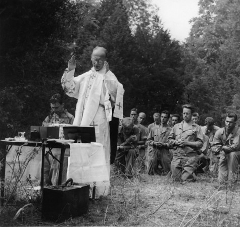 Photo courtesy of Fred Korb<br /> Father Andrejewski conducts Mass in England.  He was served in the 502nd Parachute Infantry Regiment and made all major jump missions with the troops. Fred is second soldier from the right in the front row.