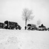 Photo courtesy of Fred Korb<br /> Troop transport vehicles  catch up with the 101st Airborne Division on the march to Bastogne, Belgium in December 1944.