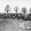 Photo courtesy of Fred Korb<br /> German soldiers line up in a holding area to undergo a complete search.
