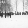 "Photo courtesy of Fred Korb<br /> American soldiers line up in the snow near 101st Airborne headquarters in Belgium  to receive awards for ""outstanding bravery"" in the Battle of the Bulge."