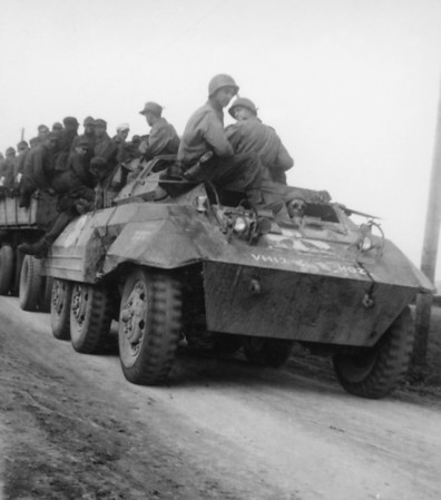 Photo courtesy of Fred Korb<br /> American soldiers in an armored vehicle bring up the rear of a prisoner-of- war convoy after Germany's May 1945 unconditional surrender.