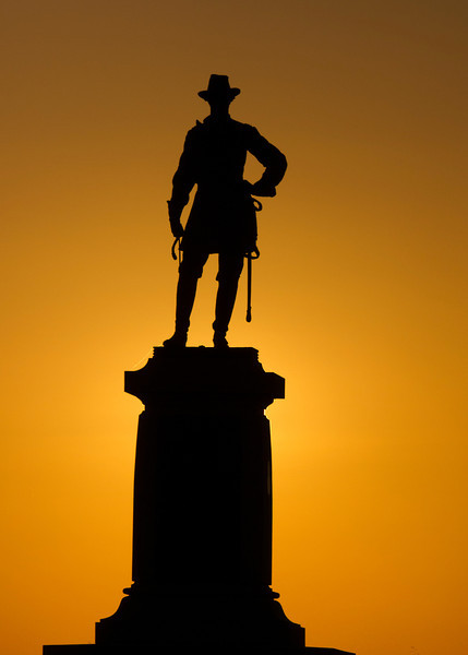 Webb monument on Cemetery Ridge at sunrise with the sun directly behind the monument