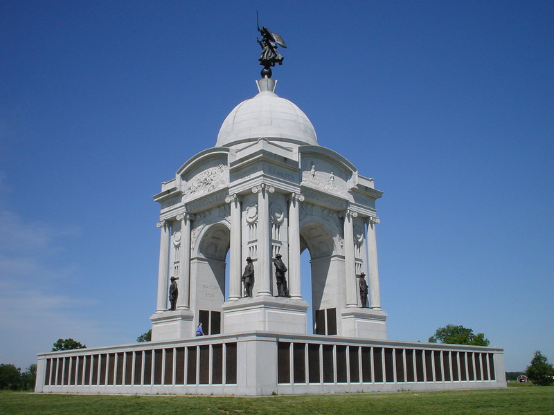 The Pennsylvania State Memorial on Cemetery Ridge, 1910.<br /> <br /> Bronze statues of Pennsylvania generals George Meade, John Reynolds, Winfield Scott Hancock, David Birney, Alfred Pleasonton and David Gregg, Governor Andrew Curtin, and President Lincoln flank each of the arches.