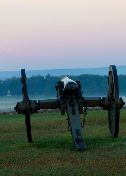 Cannon on Cemetery Ridge before sunrise with the ground fog rolling in