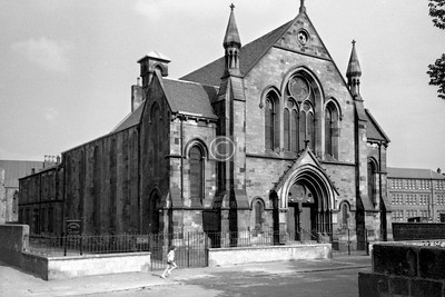 Edwin St, east side.  Cessnock Parish Church. The rear of Lambhill St School (the building is still there though no longer a school) can be seen on the right, and on the left a window and the de-slated roof of Plantation UF Church in Cornwall St.      July 1975